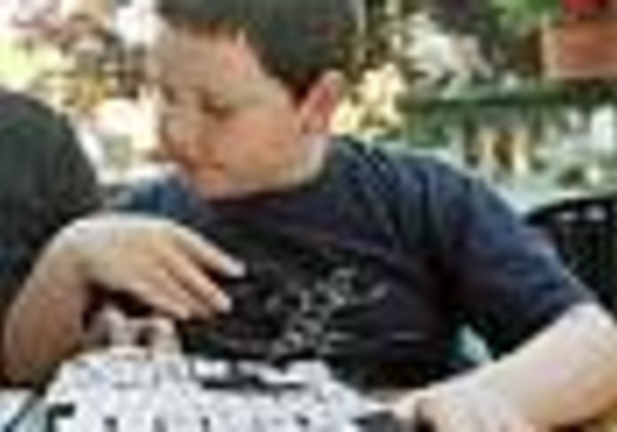 autistic child doing puzzle 88
