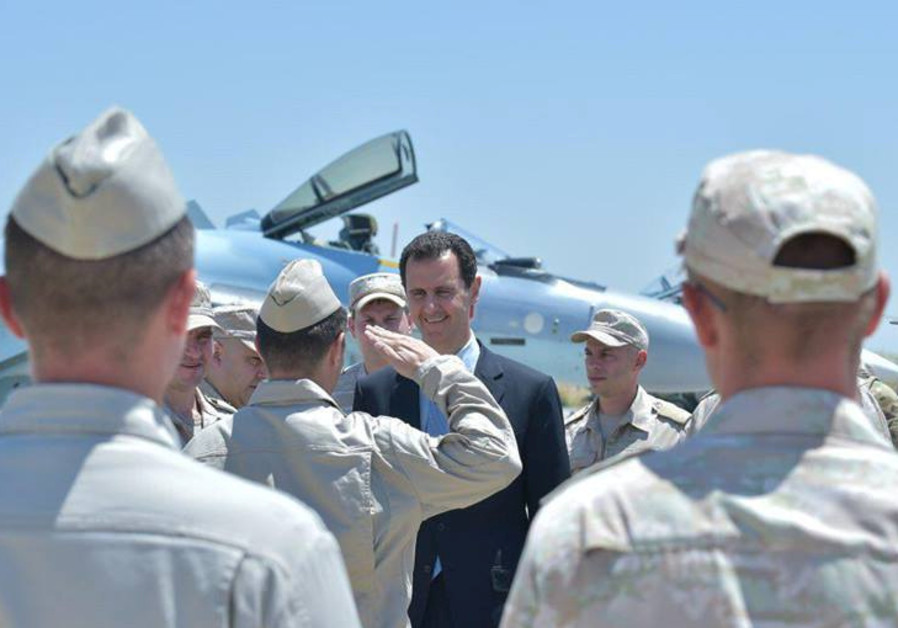 Syria's President Bashar al-Assad visits a Russian air base at Hmeymim, in western Syria / SANA/REUTERS