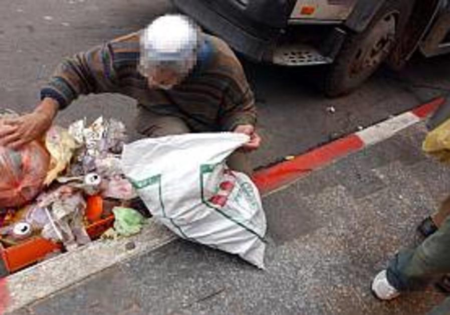 poor man poverty looks through garbage 298