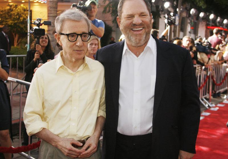 "Woody Allen, director of the new film ""Vicky Cristina Barcelona"", poses with Harvey Weinstein, co-chairman of The Weinstein Co., at the film's premiere in Los Angeles August 4, 2008 / FRED PROUSER/REUTERS"