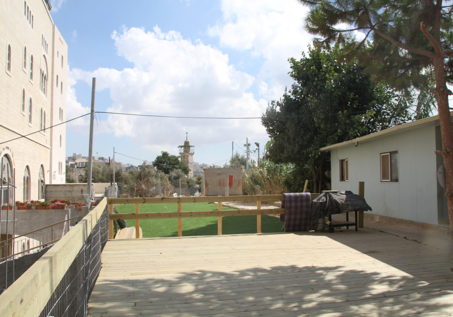 Inside the compound. The new yeshiva dormitory on the right and a modular home on the left, where the apartment building will be located.