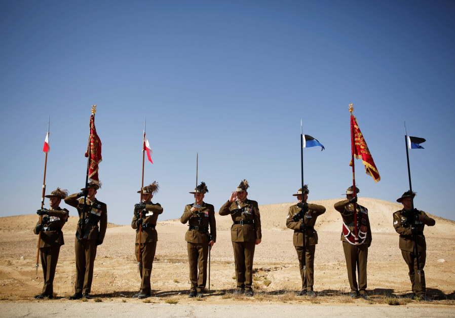 "Australian Army Cavalry Units Representing the 4th and 12th Australian Light Horse Regimental Guidons receive a salute from mounted troops during events marking centenary celebrations of the famous World War One cavalry charge, known as "" The Battle of Beersheba."""