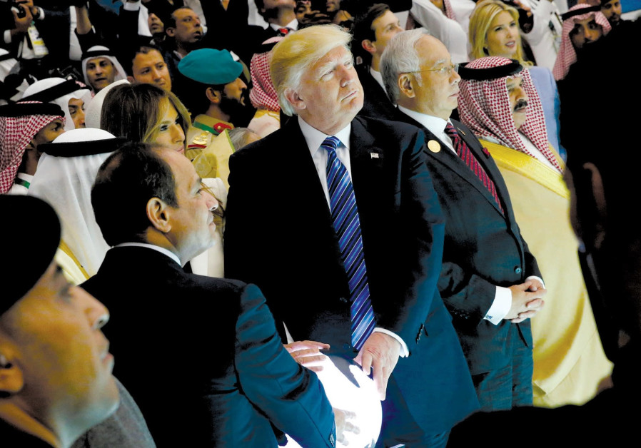 US President Donald Trump touches a glowing orb along with President Abdel Fattah al-Sisi in Riyadh, Saudi Arabia, on May 21. (Reuters)