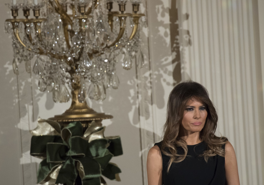 First Lady Melania Trump attends a Hanukkah reception in the East Room of the White House in Washington, DC, December 7, 2017.  SAUL LOEB / AFP