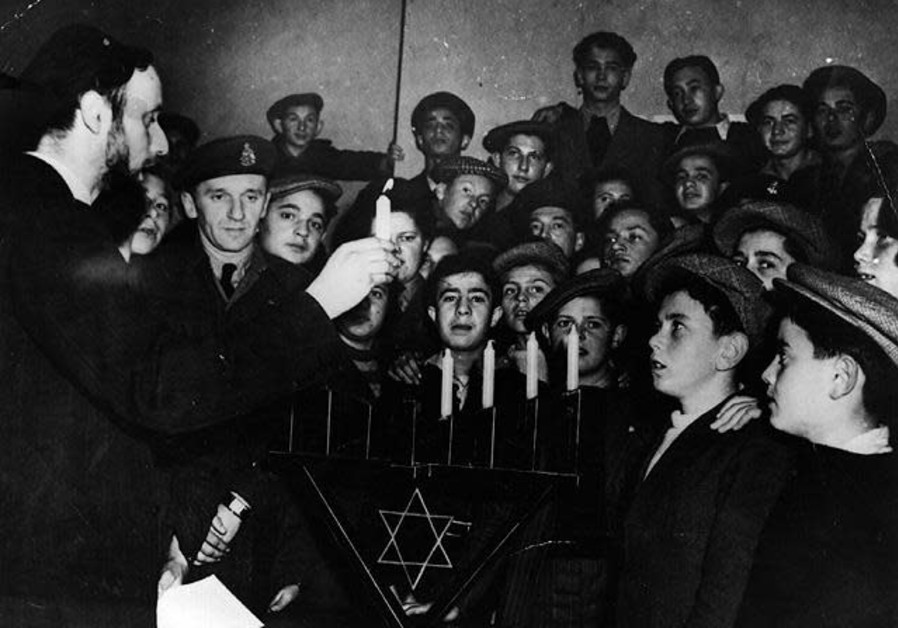 Lighting of Hanukka candles for children saved from concentration camps, England, 1945