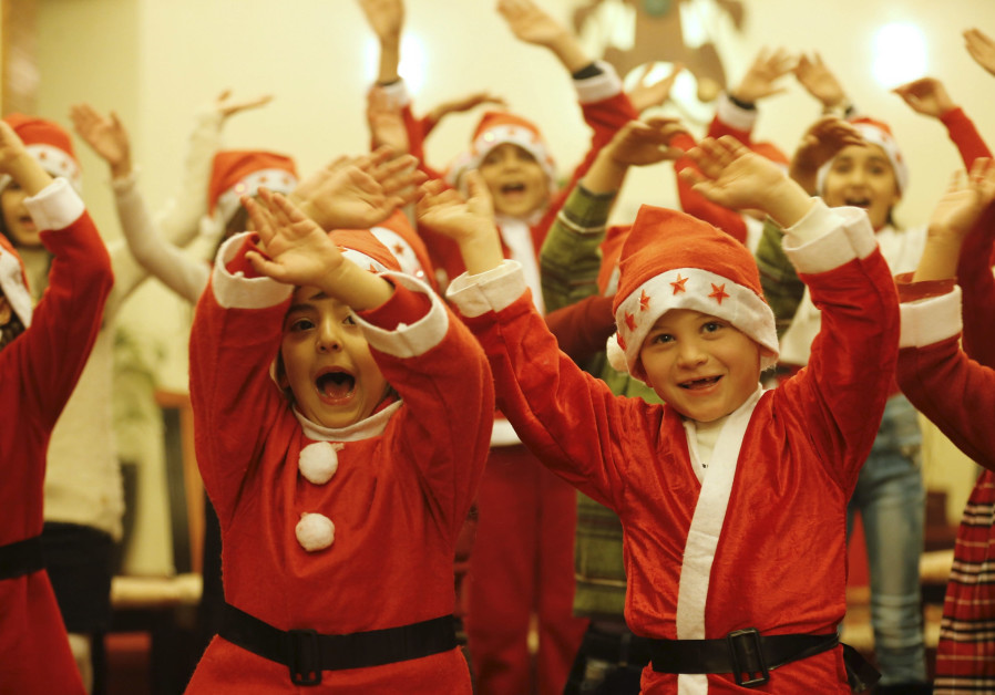 Children celebrate Christmas at the Sacred Heart Catholic Church in Baghdad, December 2015 (Credit: Thaier al-Sudani/ Reuters)