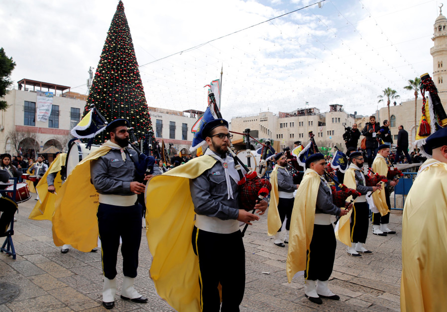 A Palestinian marching band participates in Christmas festivites in Bethlehem (credit: Ammar Awad/ Reuters)