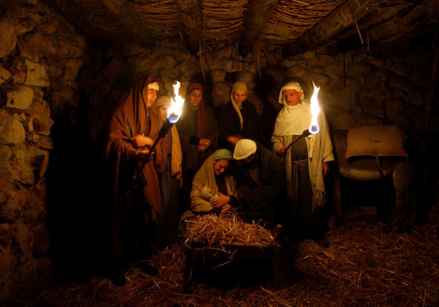 Israeli Arabs recreate the Nativity scene in Nazareth, December 2017 (Credit: Baz Ratner/ Reuters)