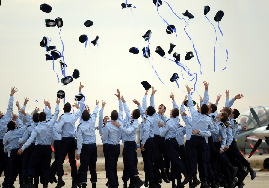 Pilots in the Israeli Air Force celebrate receiving their wings (credit: Chaim Tzach/ GPO)