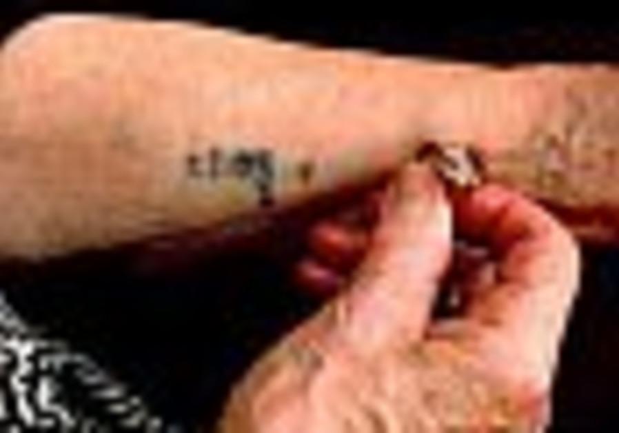 holocaust tattooed arm 88