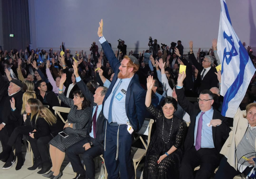 Likud Central Committee members vote to endorse exercising Israel's sovereignty over Judea and Samaria last night at Airport City. (Photo: Avashalom Sasoni)