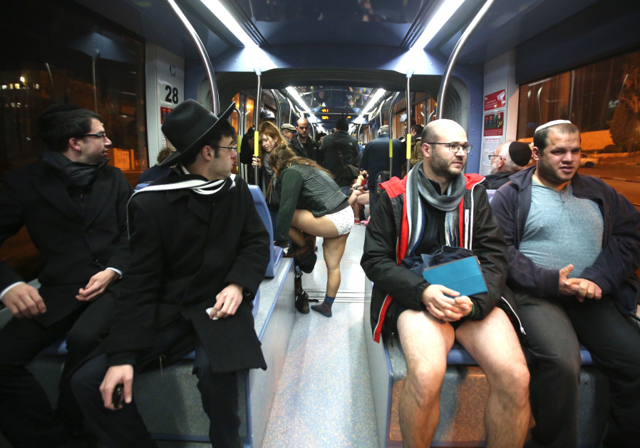 "Israelis take part in an annual ""No Pants Day"" on Jerusalem's Light Rail (credit: Marc Israel Sellem/ Jerusalem Post)"