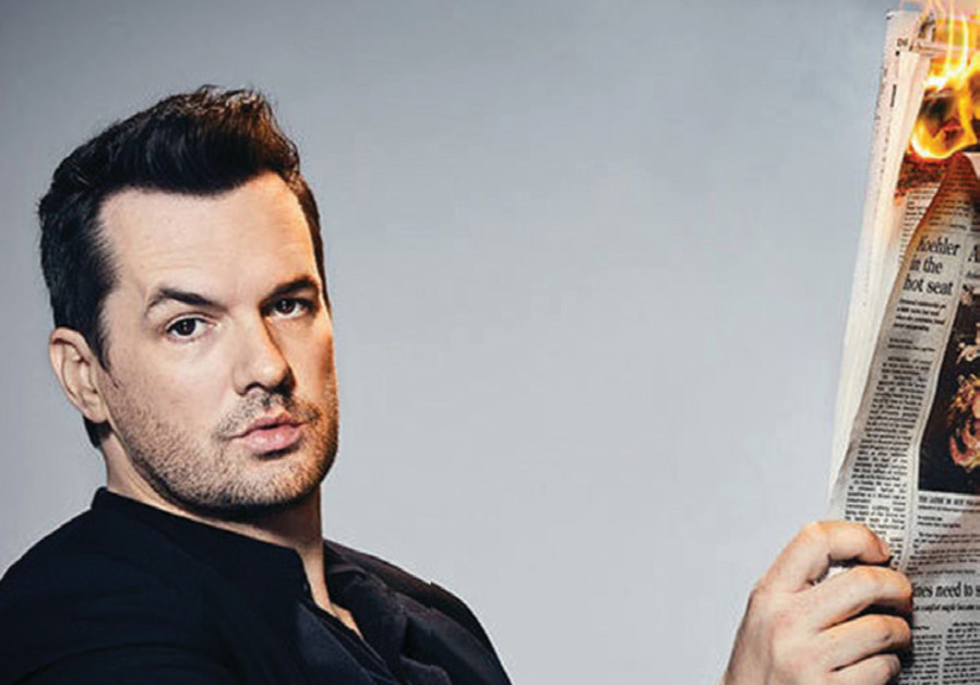 Jim Jefferies with his newspaper on fire.