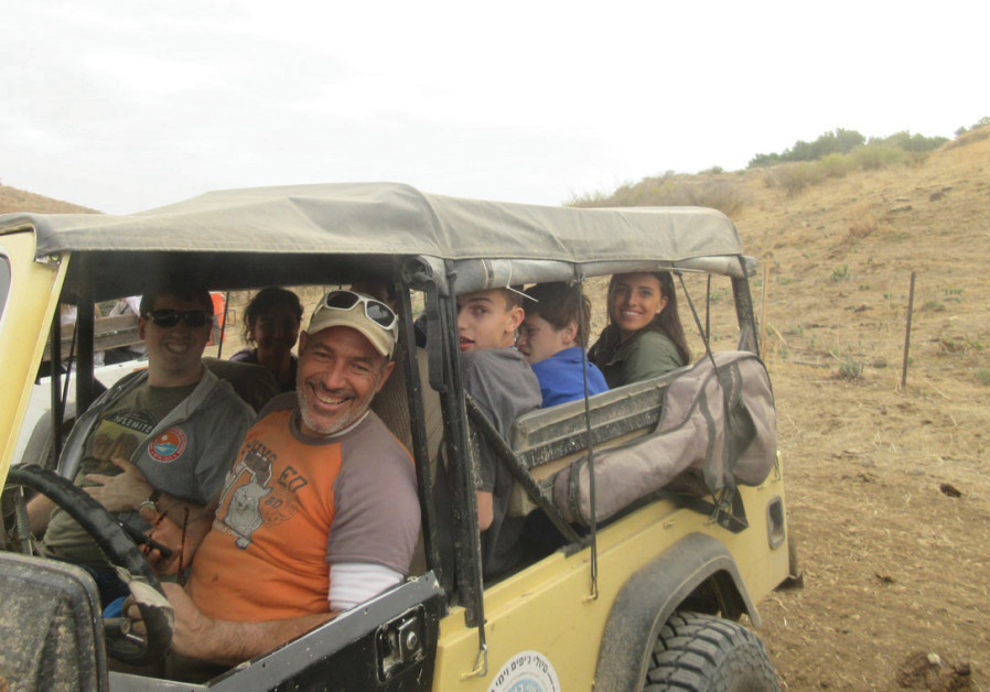 Special-needs young adults on Birthright trip enjoying a jeep ride.