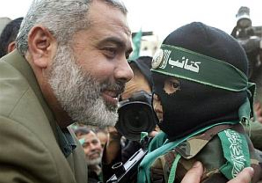 hania smiles with hamas child. sick stuff 298 ap