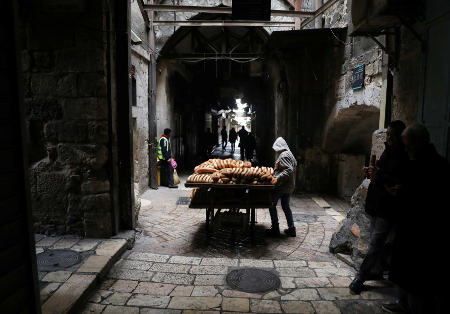 A street vendor selling baked goods stands in a street in which closed shops can be seen, as Palestinian political parties call for a general strike protesting the visit of U.S. Vice President Mike Pence in Jerusalem and the U.S. recognition of Jerusalem as Israel's capital, in Jerusalem's Old City Ammar Awad/ Reuters