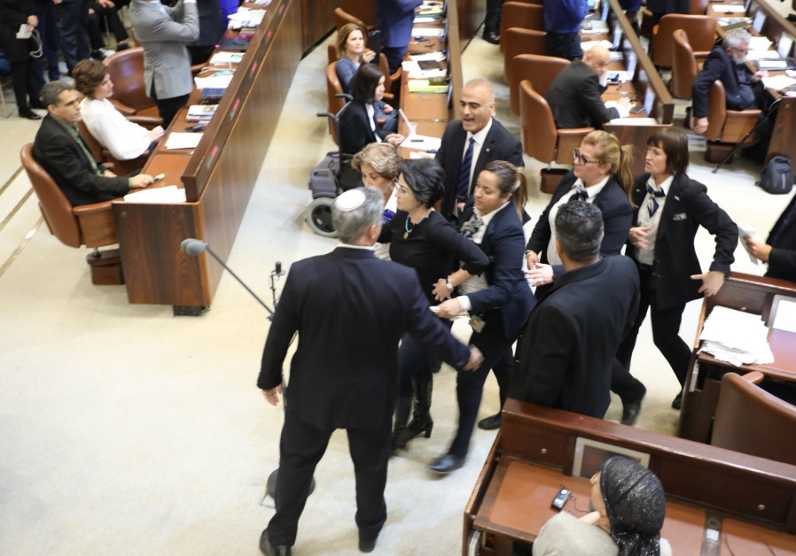 MK Haneen Zoabi [Balad] removed from Knesset after protesting during speech by US Vice President Mike Pence  YITZHAK HARARI