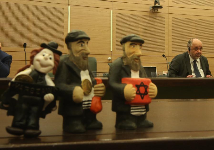 Polish ambassador to Israel Jacek Chodorowicz with Jewish dolls used in Poland / MARC ISRAEL SELLEM/THE JERUSALEM POST
