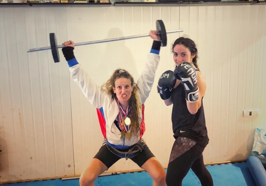 Jerusalem Post reporter Anna Ahronheim, dressed as a boxer for Purim, with Israeli kickboxing champion Adi Rotem (credit: Courtesy: Anna Ahronheim)