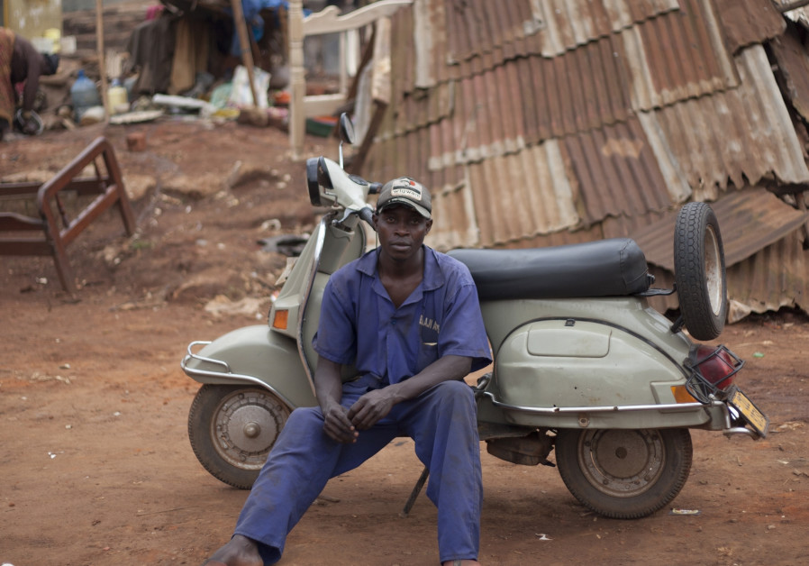 "A portrait from ""Uganda's Vespa Club"" (credit: Ariel Tagar)"