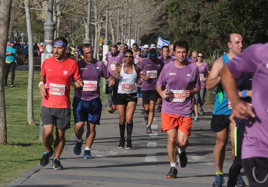 Runners participate in the Jerusalem Marathon (credit: Marc Israel Sellem/ The Jerusalem Post)