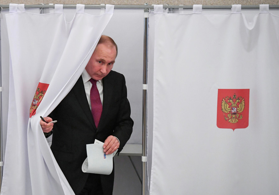 Vladimir Putin at a polling station during the presidential election in Russia.(photo credit: REUTERS/YURI KADOBNOV/POOL)