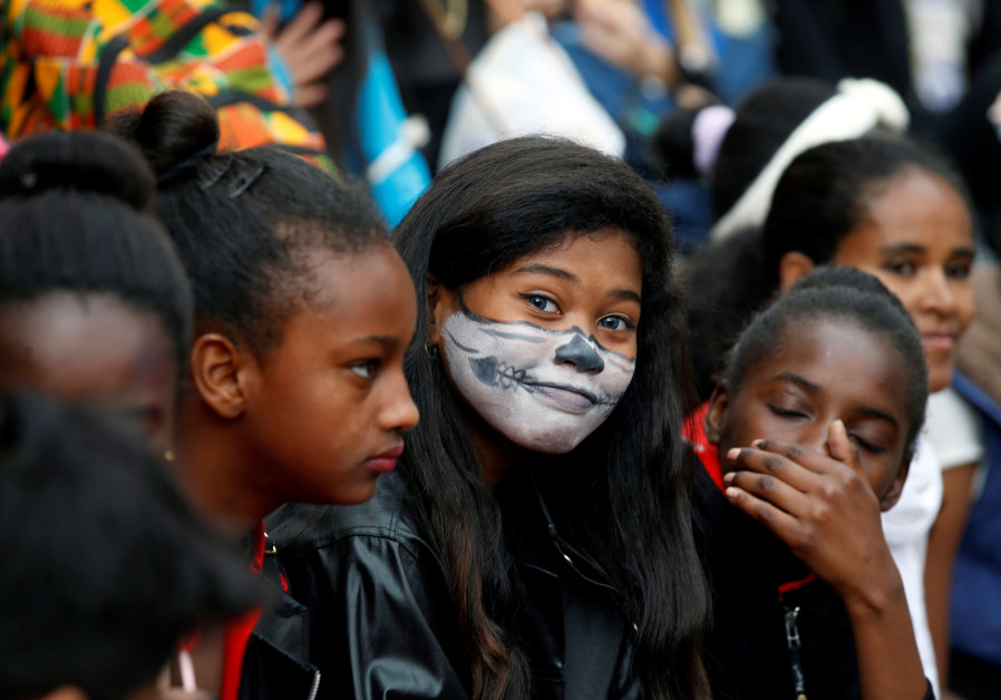 A girl looks at the camera during an event marking the Jewish holiday of Purim at the Bialik Rogozin school, where children of migrant workers and refugees are educated alongside native Israelis, in Tel Aviv, Israel March 10, 2017. BAZ RATNER/REUTERS
