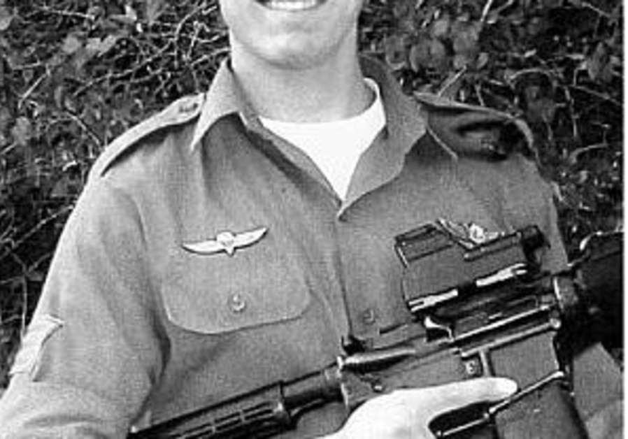 yosef goodman in uniform with gun 298
