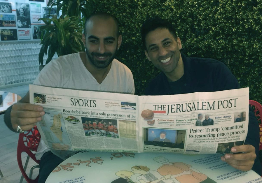 SHAHAR HASON (right) and Yohay Sponder turn their rapt attention to 'The Jerusalem Post.'