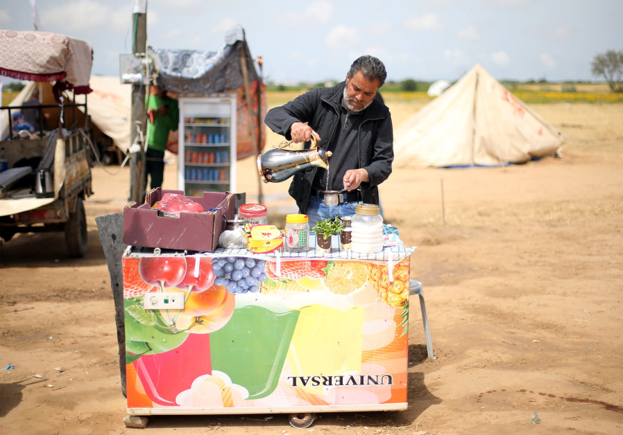 A Palestinian man sells tea and coffee during a tent city protest at Israel-Gaza border, in the southern Gaza Strip April 3, 2018 /  IBRAHEEM ABU MUSTAFA / REUTERS