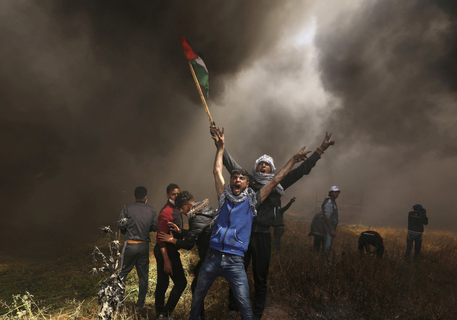 Palestinians burn tires during Gaza protests (Mohammed Salem/ Reuters)