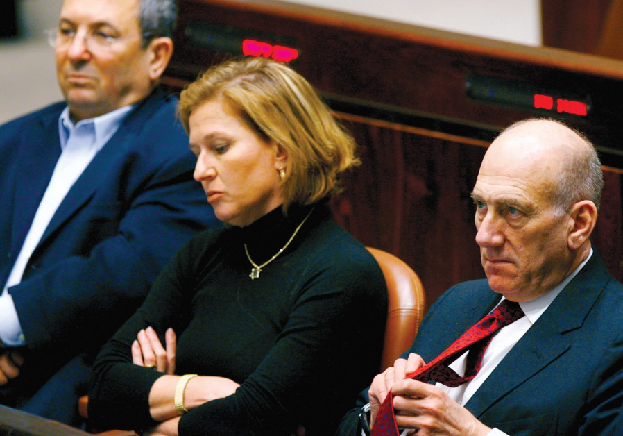THEN-PRIME MINISTER Ehud Olmert (right), foreign minister Tzipi Livni and defense minister Ehud Barak attend a special session in the Knesset marking Holocaust Remembrance Day in 2008. / Reuters