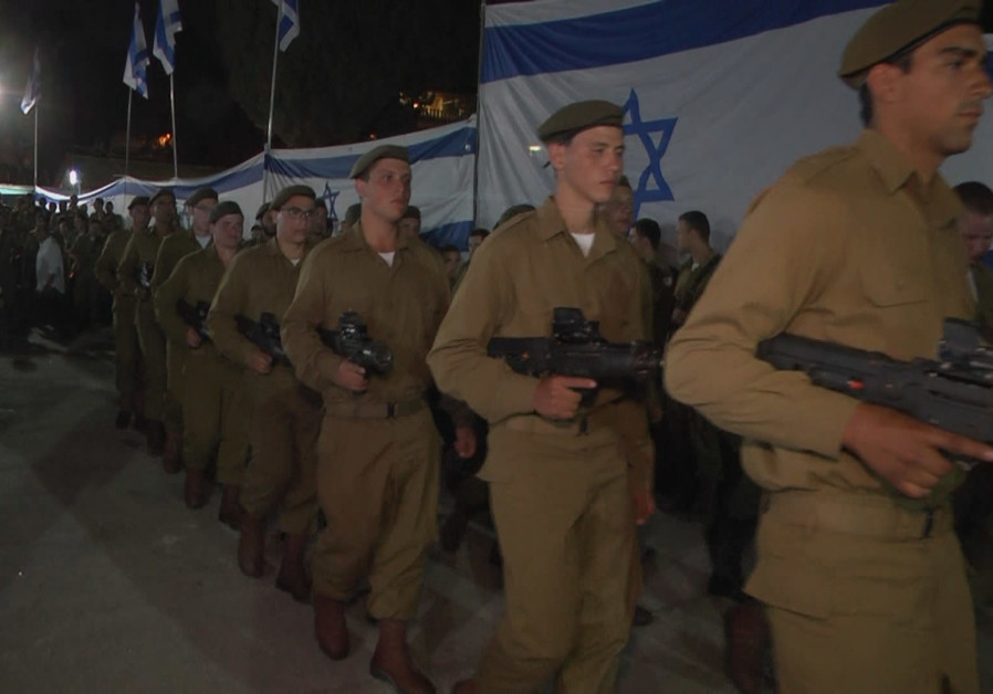Soldiers with disabilities march in the Remembrance Day ceremony in Jerusalem