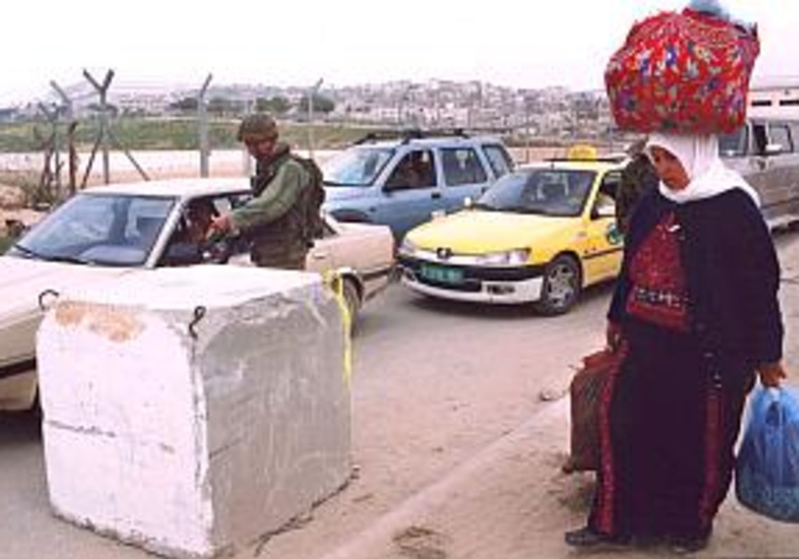 soldier inspecting cars at kalandia arab palestini