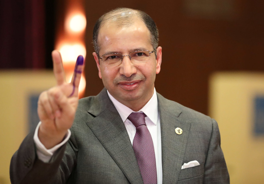 Iraqi Speaker of Parliament Salim al-Jabouri shows his ink-stained finger after casting his vote at a polling station during the parliamentary election in Baghdad, Iraq May 12, 2018 / AHMED JADALLAH / REUTERS