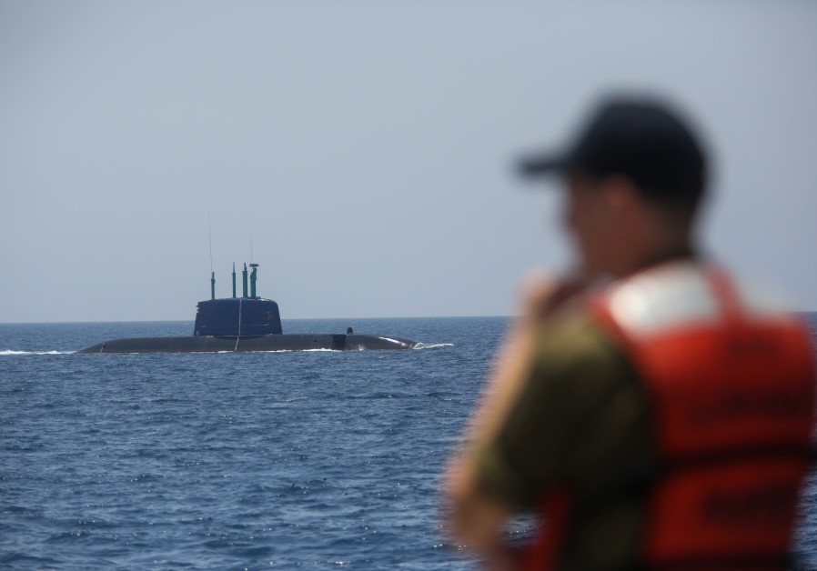 A soldier overlooks the Israeli navy's Dolphin-class submarine (Marc Israel Sellem)