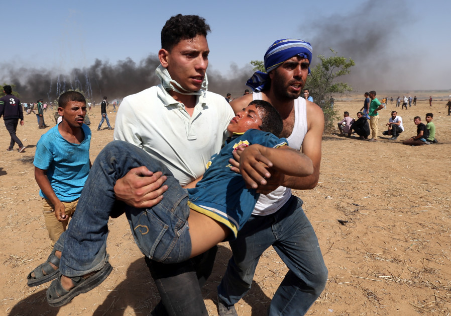 A wounded Palestinian boy is evacuated during a protest marking al-Quds Day, (Jerusalem Day), at the Israel-Gaza border in the southern Gaza Strip June 8, 2018. IBRAHEEM ABU MUSTAFA / REUTERS