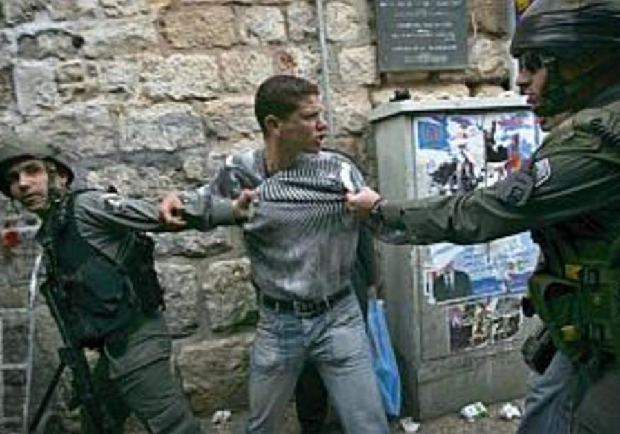 police hold e. jerusalem protester ap 298