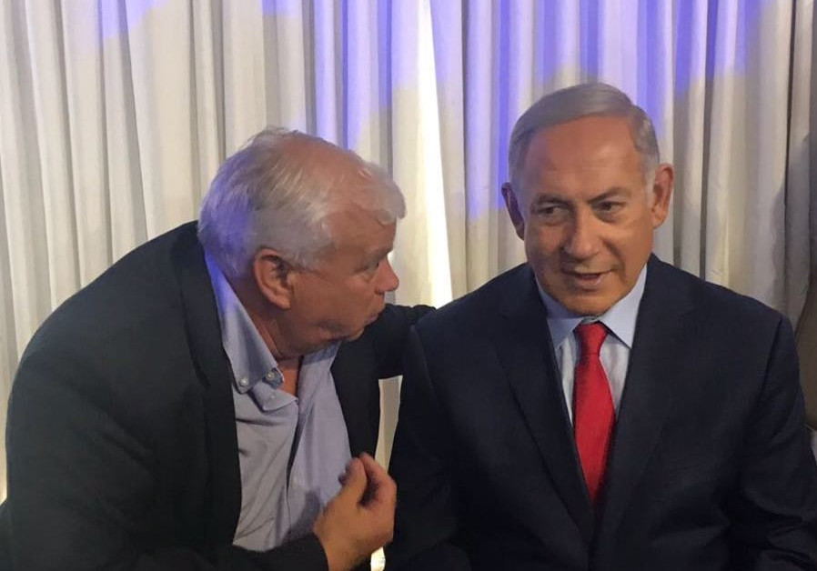 Prime Minister Benjamin Netanyahu speaks to the Likud's top candidate for the Jerusalem city council, Elisha Peleg, at a Likud event at Ramat Gan's Kfar Hamaccabiah Hotel. (Courtesy Peleg)