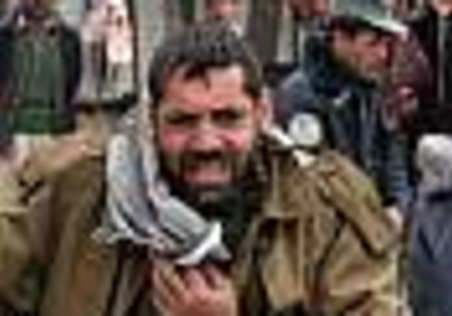 Dozens killed in Afghan suicide attack outside US base