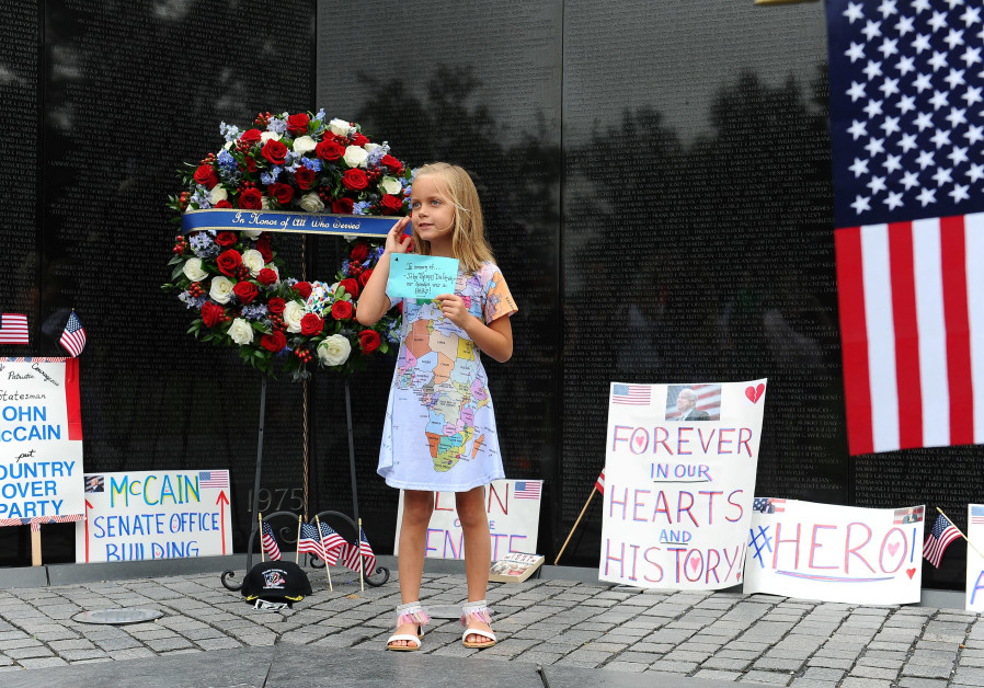 Eliana Duy, 8, FL, stands in front of the wreath that U.S. Secretary of Defense James Mattis, General John Kelly, White House Chief of Staff and Cindy McCain, wife of late Senator John McCain, lay a ceremonial wreath honoring all whose lives were lost during the Vietnam War at at the Vietnam Veteran /  ARY F. CALVERT / REUTERS