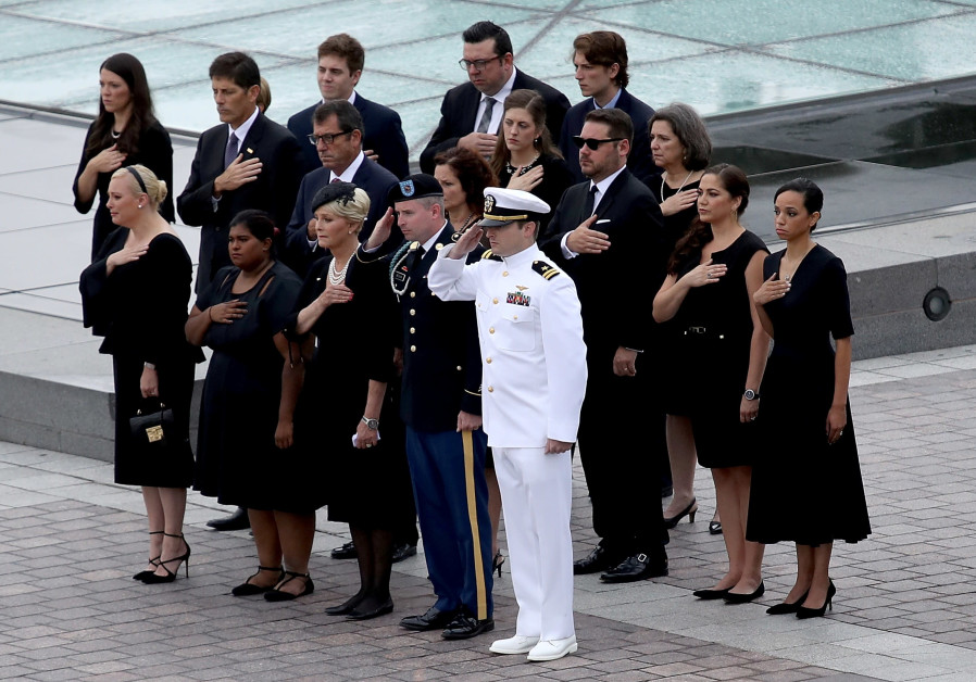 Members of the McCain family watch as a military honor guard team carries the casket of the late-Sen. John McCain (R-AZ) from the U.S. Capitol September 1, 2018 in Washington, DC. The late senator died August 25 at the age of 81 after a long battle with brain cancer. Sen. McCain will be buried at his final resting place at the U.S. Naval Academy on Sunday. / Reuters