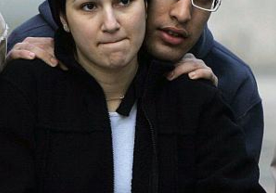worried israeli couple comfort each other 298