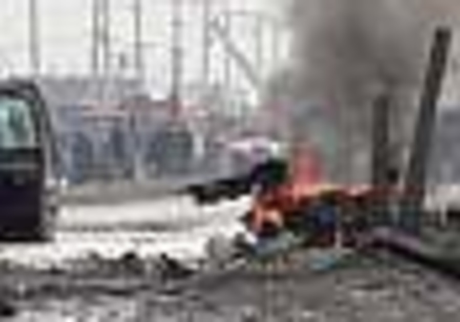 Bomber kills s. Afghan district chief, 3 of his kids