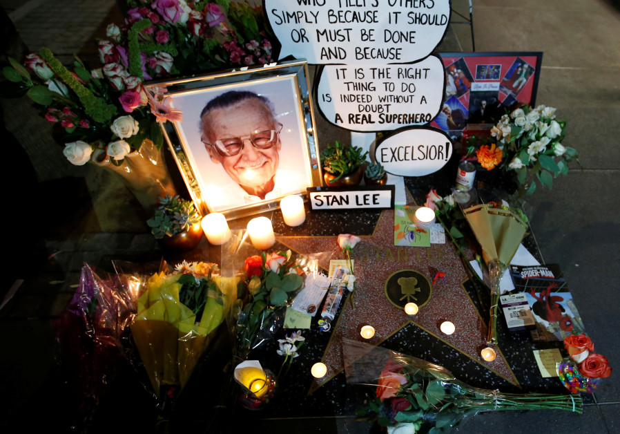 Flowers and mementos are pictured on the star of late Marvel Comics co-creator Stan Lee on the Hollywood Walk of Fame in Los Angeles, California, U.S., November 12, 2018. / MARIO ANZUONI/REUTERS