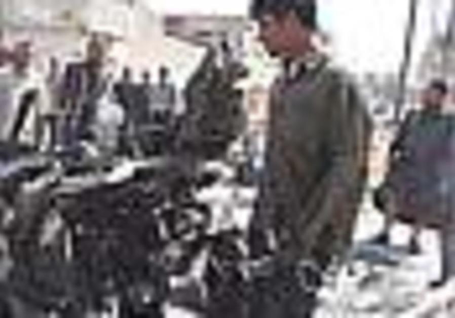 Iraq: Truck bomber kills 15, wounds nearly 200