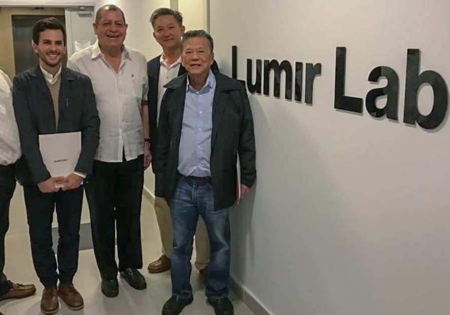 Jamaican delegation with CEO Yotam Hod at Lumir Lab (photo credit: Courtesy)
