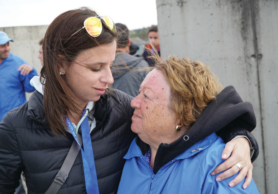 MICHELLE EKSTEIN comforts her grandmother, Anita Ekstein / Courtesy