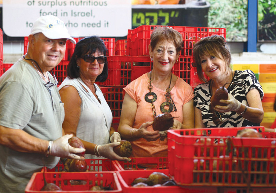 Leket Israel volunteers sort out produce at its logistics center. (Photo: Leket Israel)