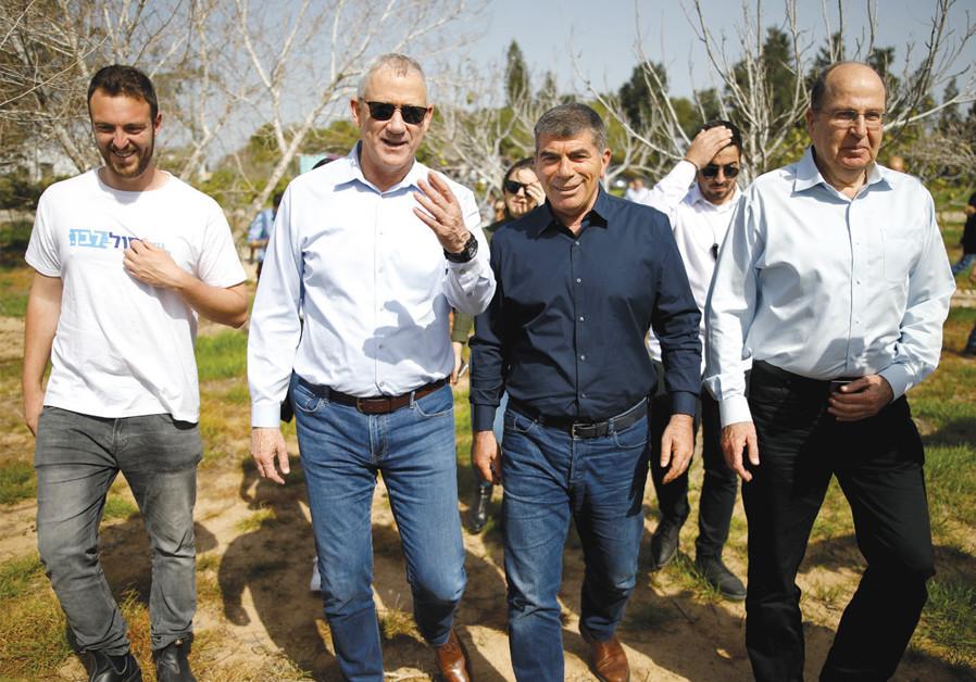 Benny Gantz, head of the Blue and White Party, visits Kibbutz Kfar Aza near the Gaza Strip on March 13 with party candidates Gabi Ashkenazy and Moshe Ya'alon. (Amir Cohen/Reuters)